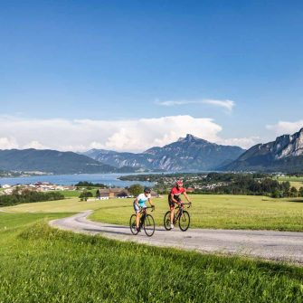 Cycling Austria with a lake behind and meadows