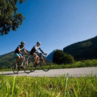 Two cyclsits cycling through Grossglockner region Austria (credit Pinzgau_Heiko Mandl)