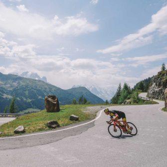 Cyclist descending a Swiss mountain pass