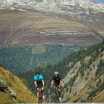 Two cyclists climb the Nufenen Pass, Switzerland