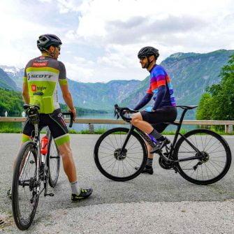 Admiring the view during a Slovenia cycling holiday at Lake Bohinj Slovenia