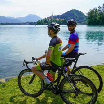 Two cyclists admiring Lake Bled in Slovenia