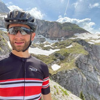 Cyclist on Mangarts Saddle, cycling Slovenian Alps
