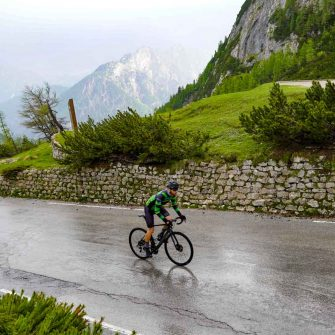 Cyclist at the summit of the Vrisc Pass, Slovenia