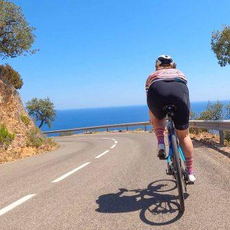 Cyclist by the sea in Costa Brava