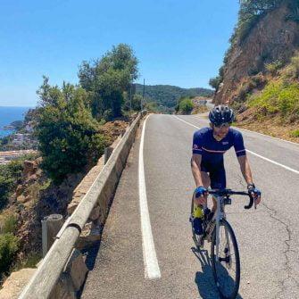 Road winding down the Costa Brava coastline near Tossa del Mar, Catalonia, Spain
